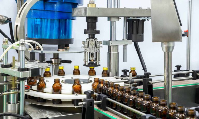 Sterile bottles on the production line conveyor of the pharmaceutical industry. Machine for iquid drugs glassware bottling.